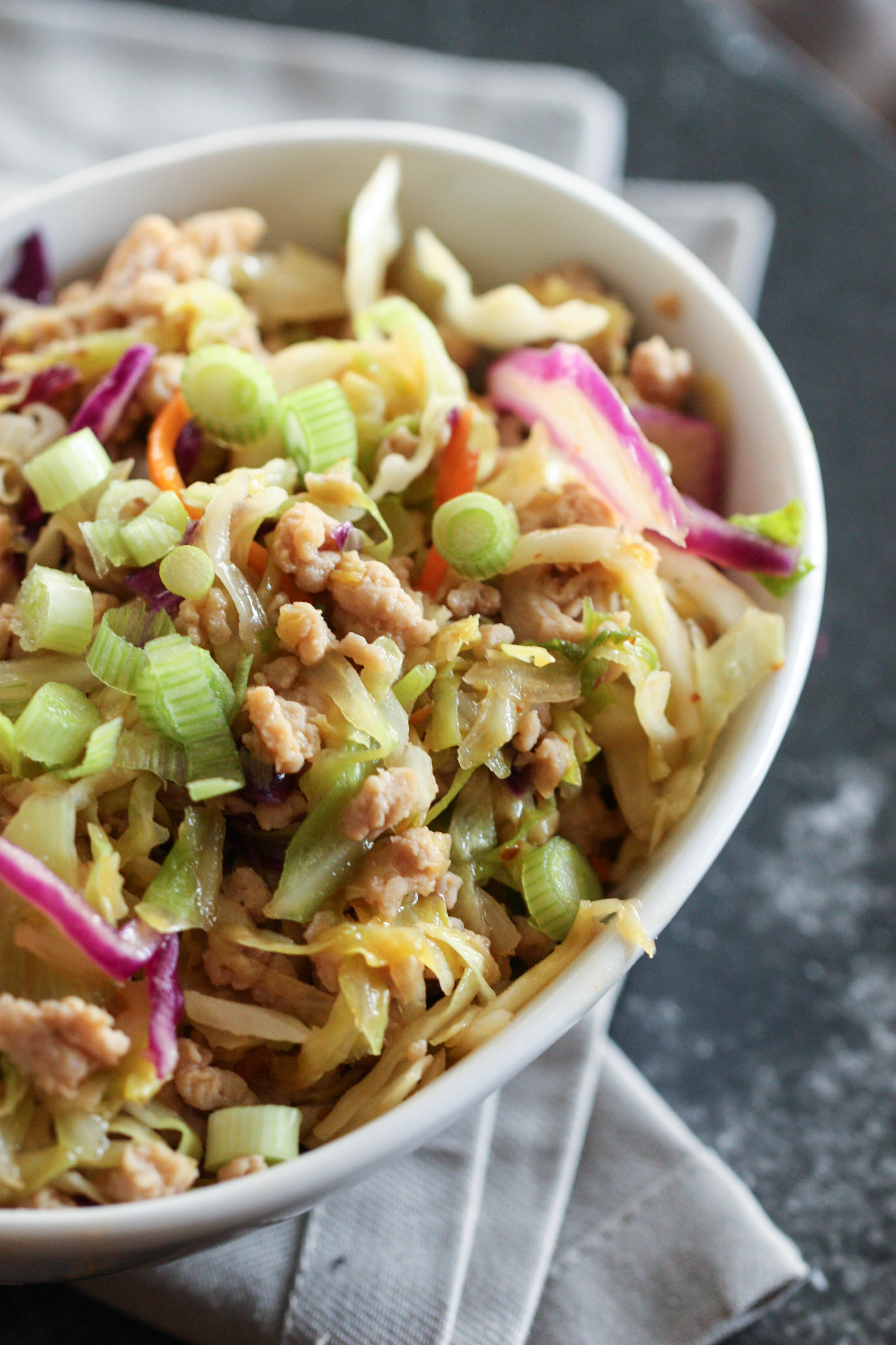 Close up of Egg Roll in a bowl, in a white bowl