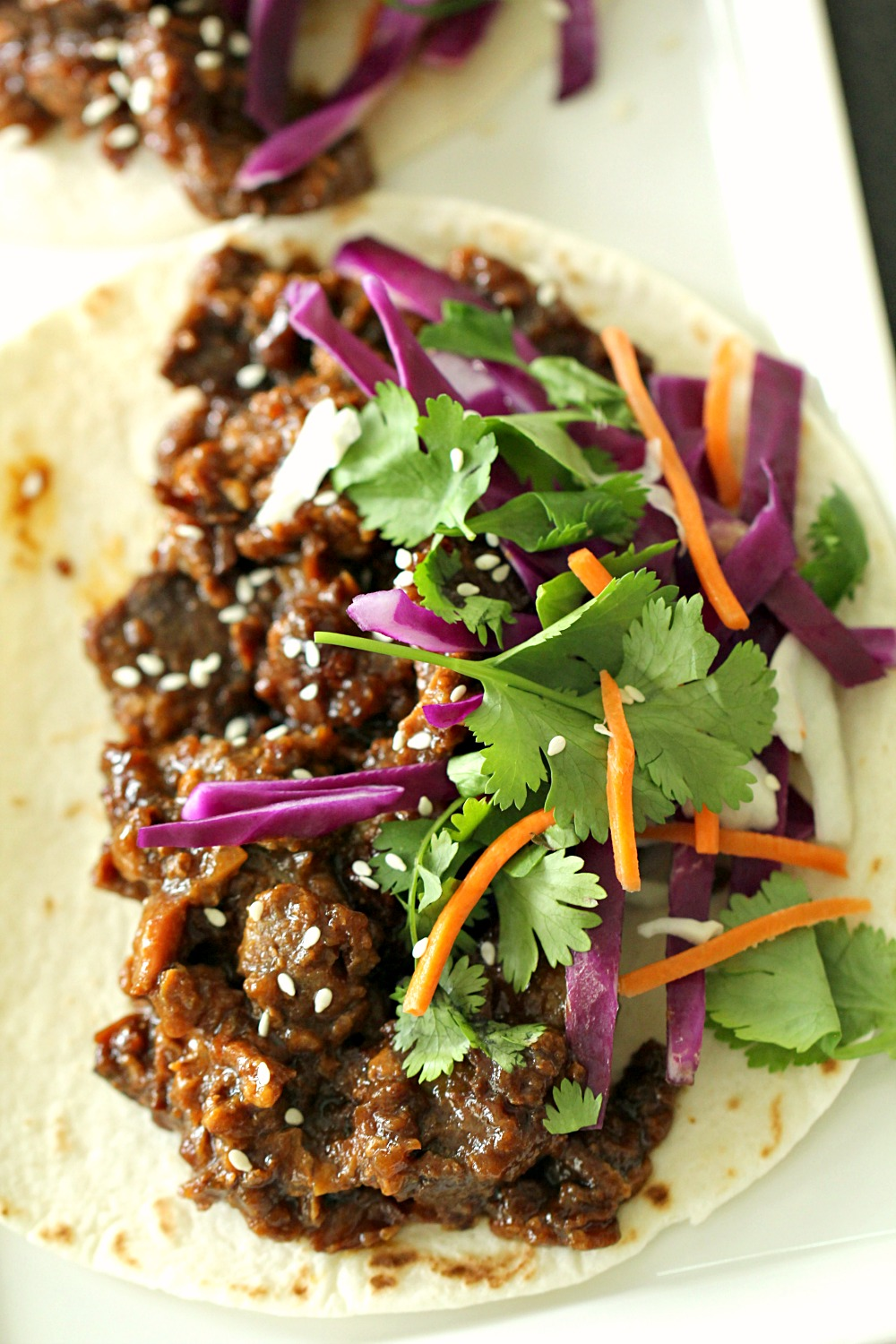 Korean Beef on flour tortillas with toppings
