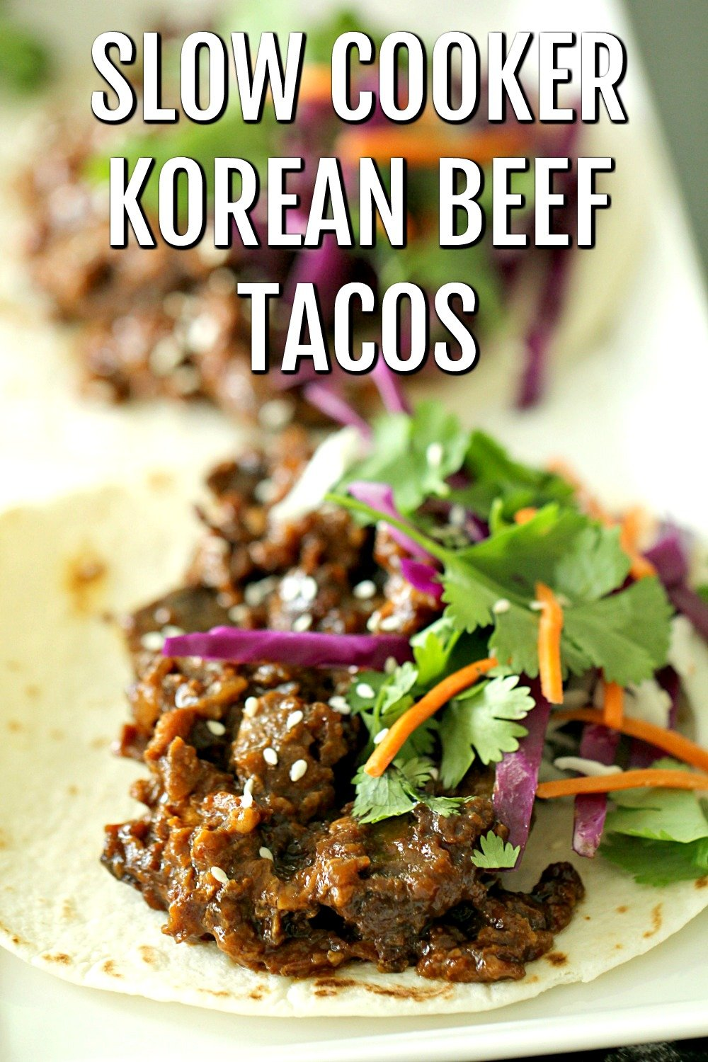 Slow Cooker Korean Beef in tacos with toppings