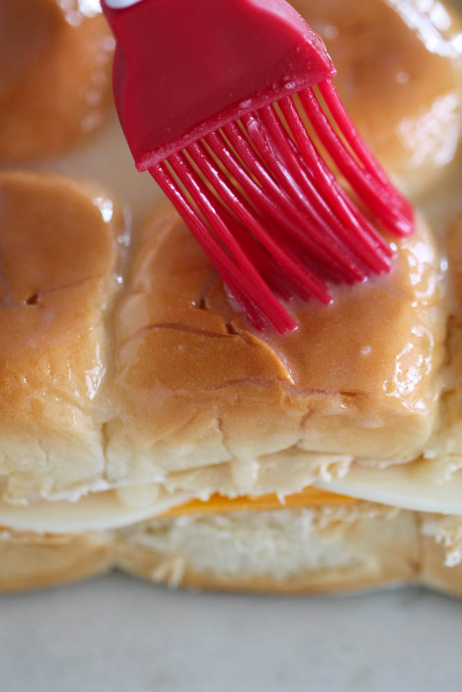 Brushing butter on Grilled Cheese Sliders