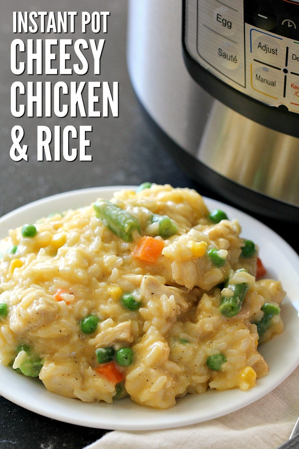 cheesy chicken and rice with mixed vegetables on a plate next to an Instant Pot
