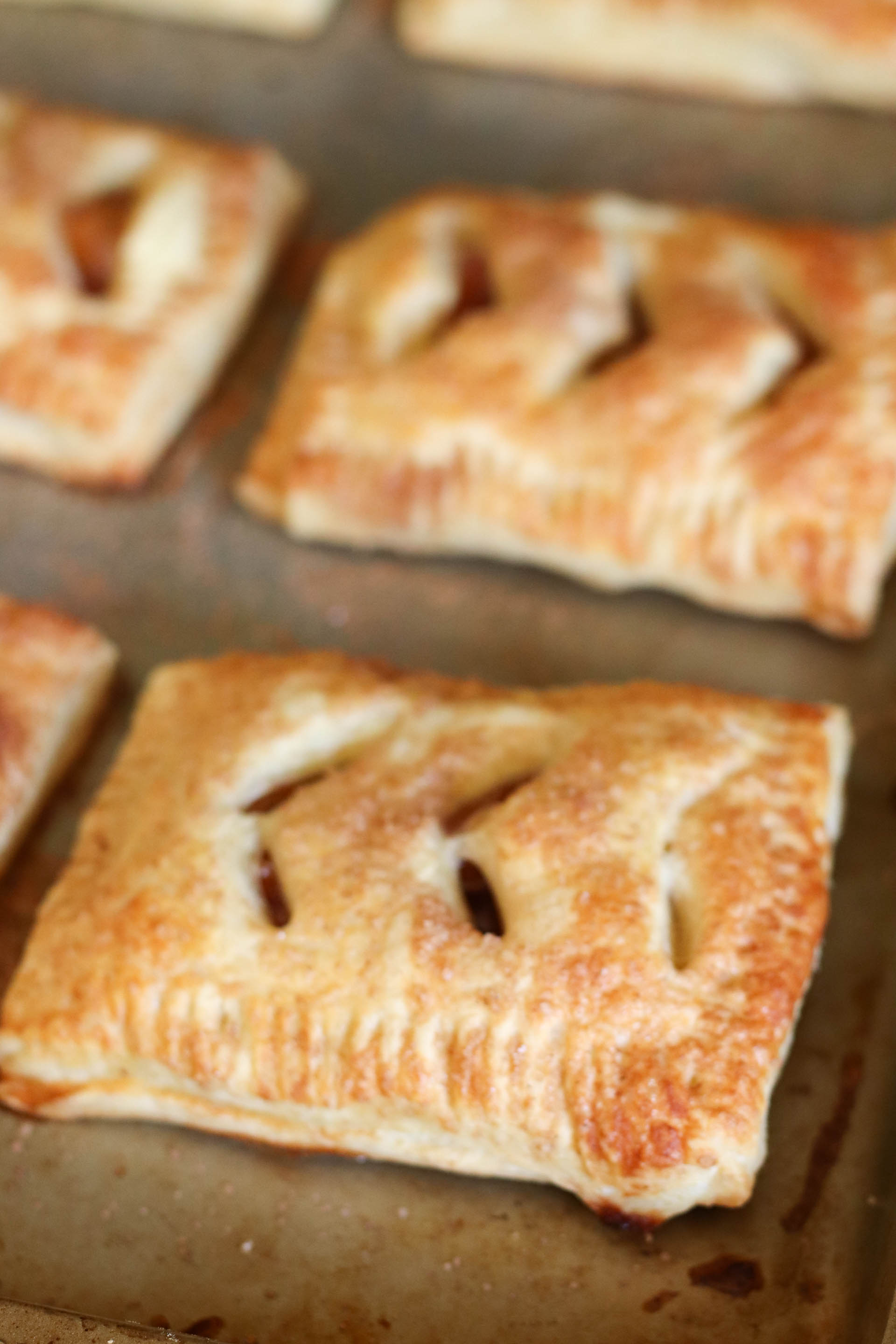 Baked Peach Hand Pies on baking sheet