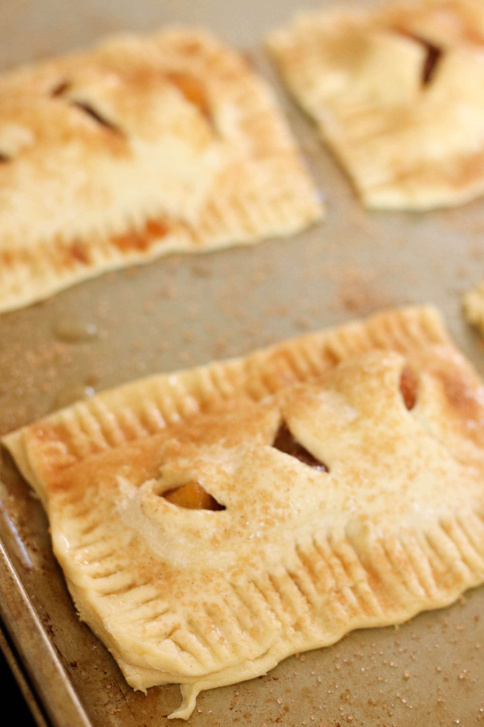 Unbaked Peach Hand Pies on baking sheet