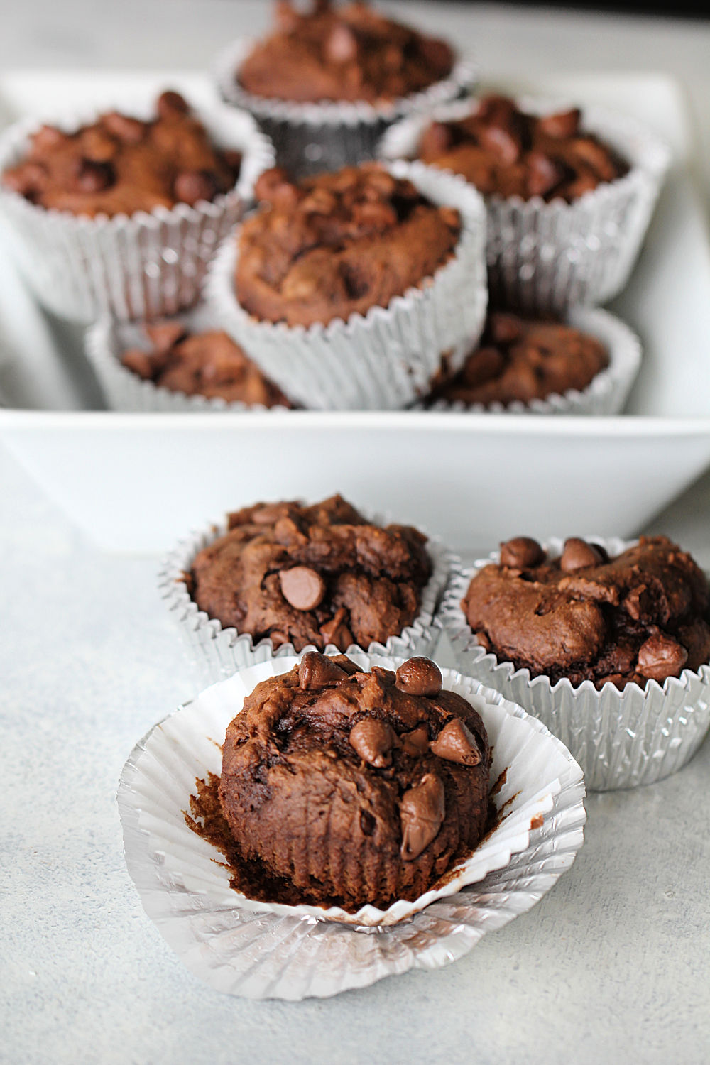 Chocolate Pumpkin Muffins wrapped in muffin liners