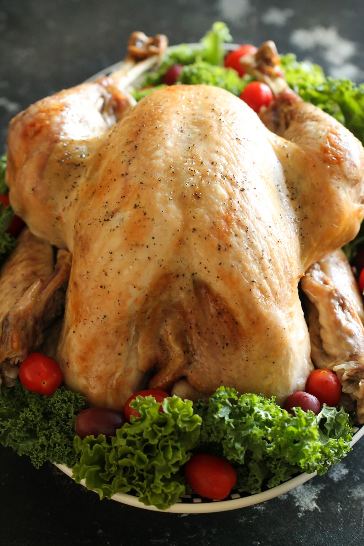 Baked whole turkey on platter on six sisters stuff