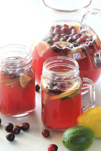 Cranberry Punch poured in mugs and pitcher