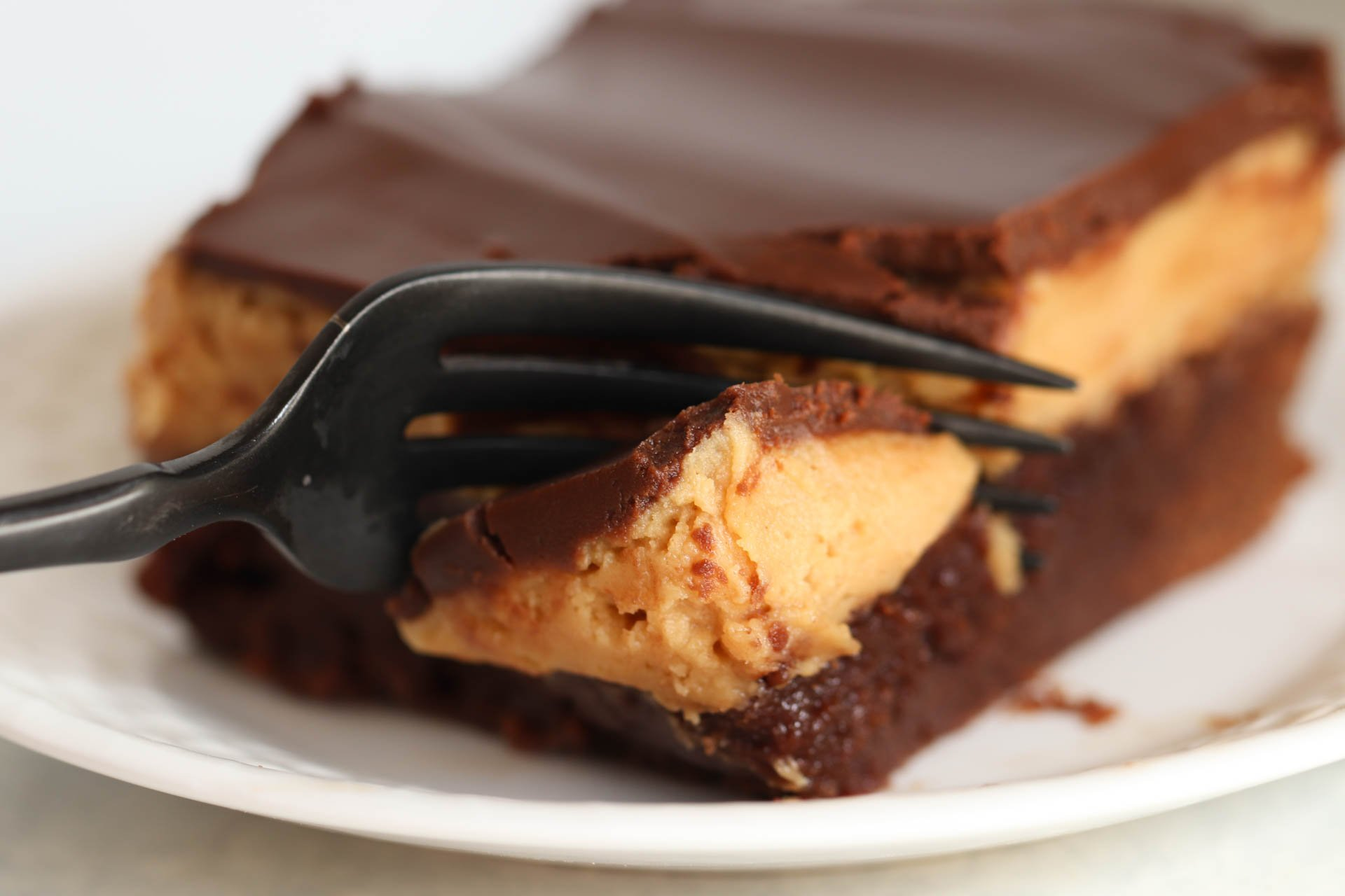 Buckeye Brownie Square on a white plate with a fork