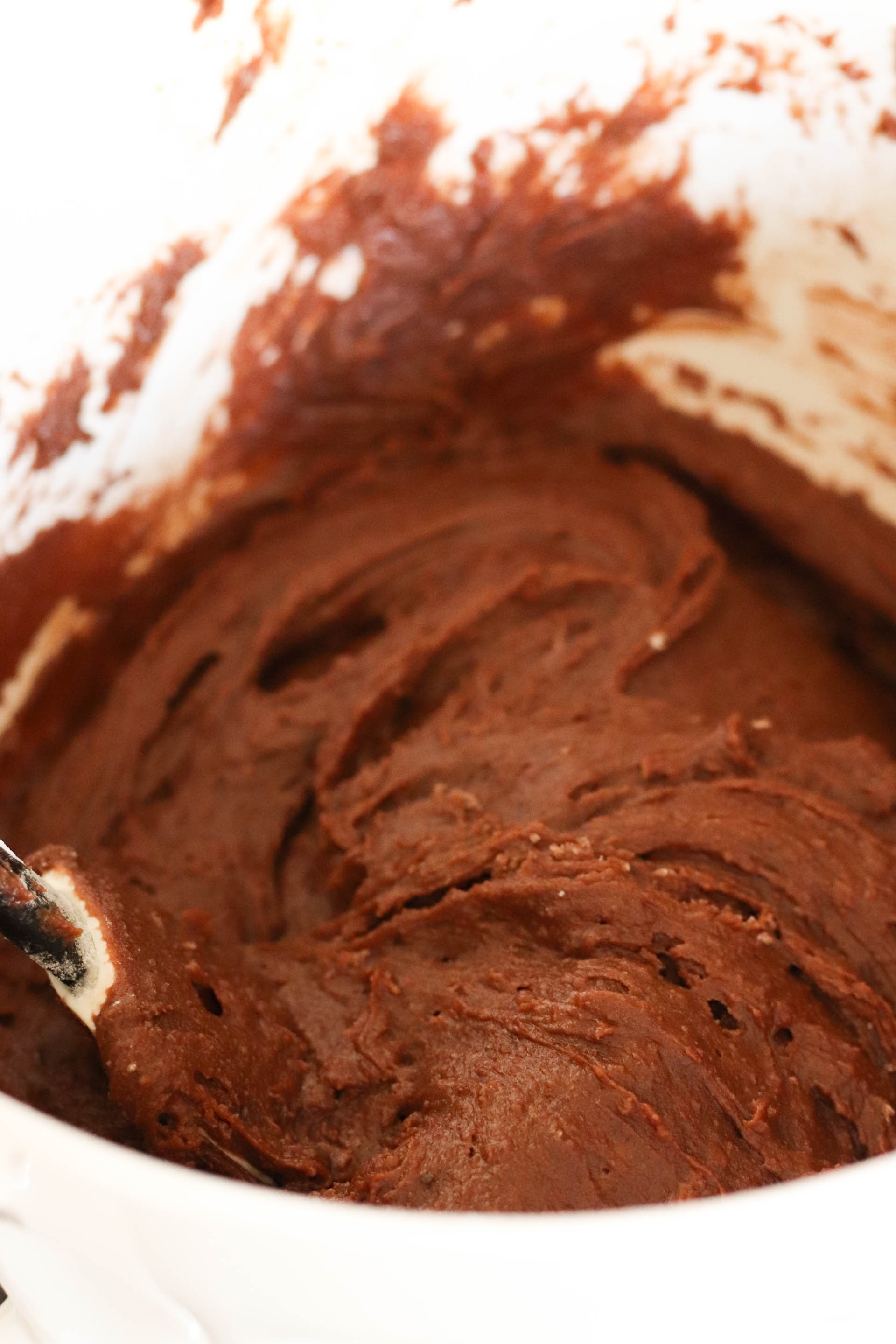 Brownie mixture in mixing bowl with a rubber spatula