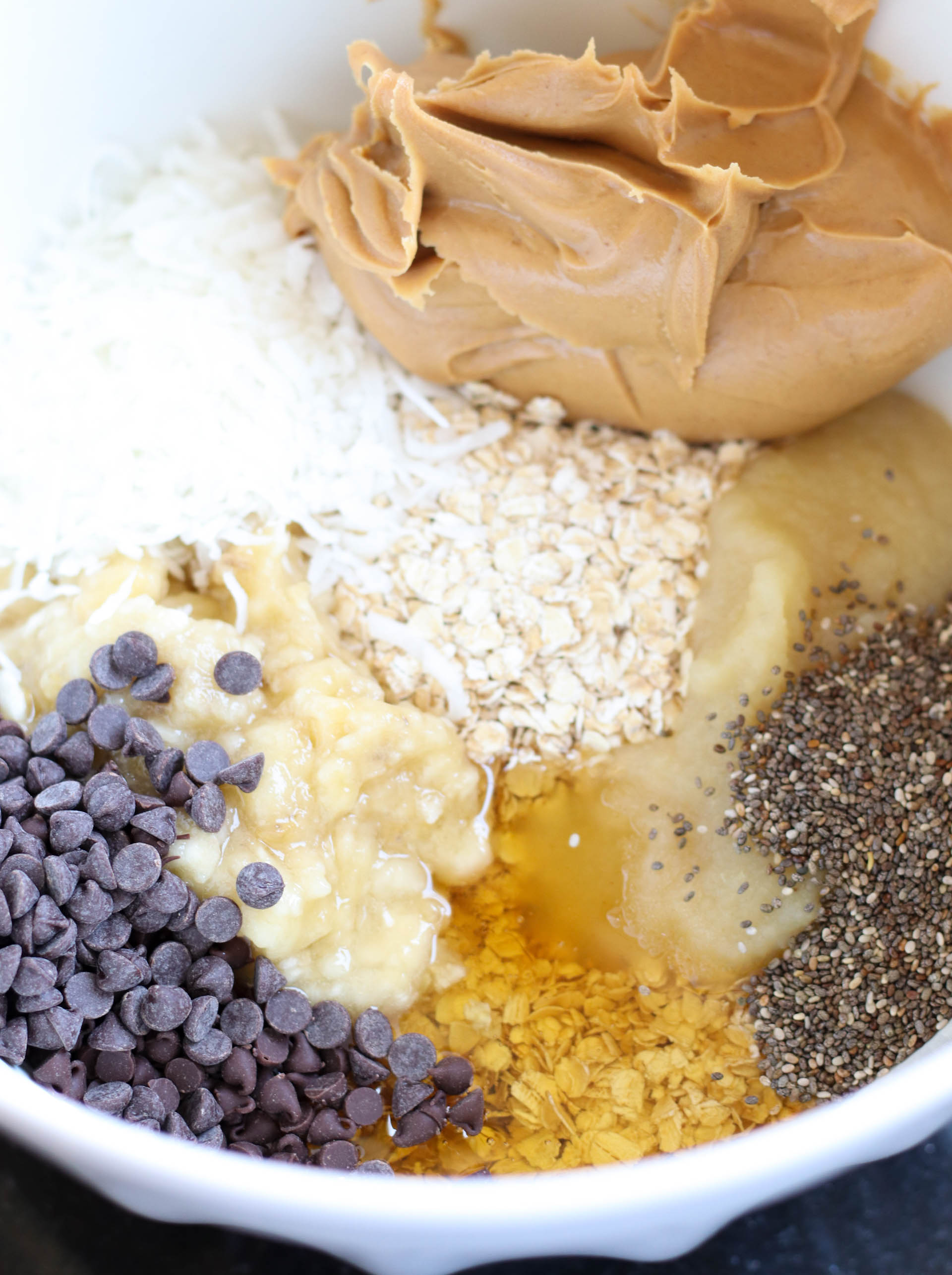 Ingredients for Breakfast Cookies in a white mixing bowl