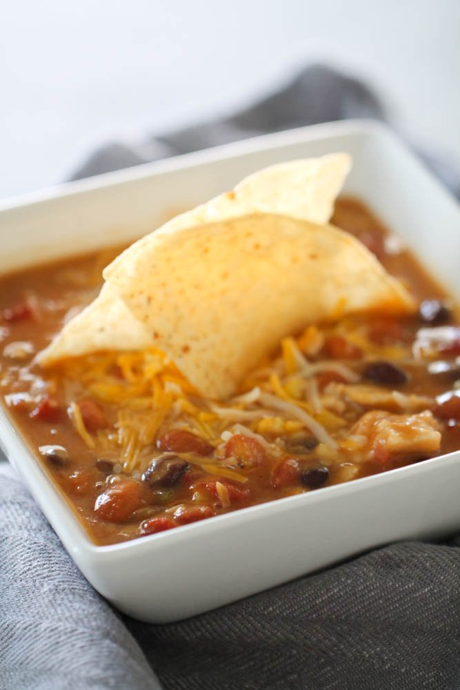 instant pot 7 can tortilla soup with cheese and tortilla chips on top