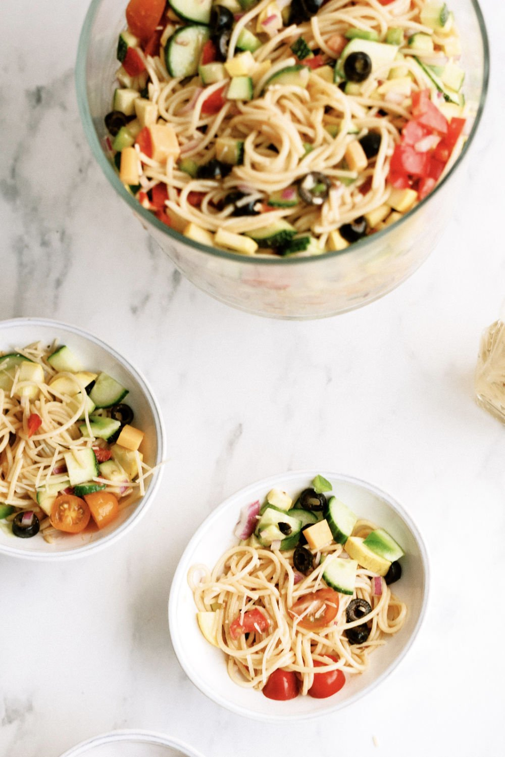 pasta salad with vegetables served in bowls