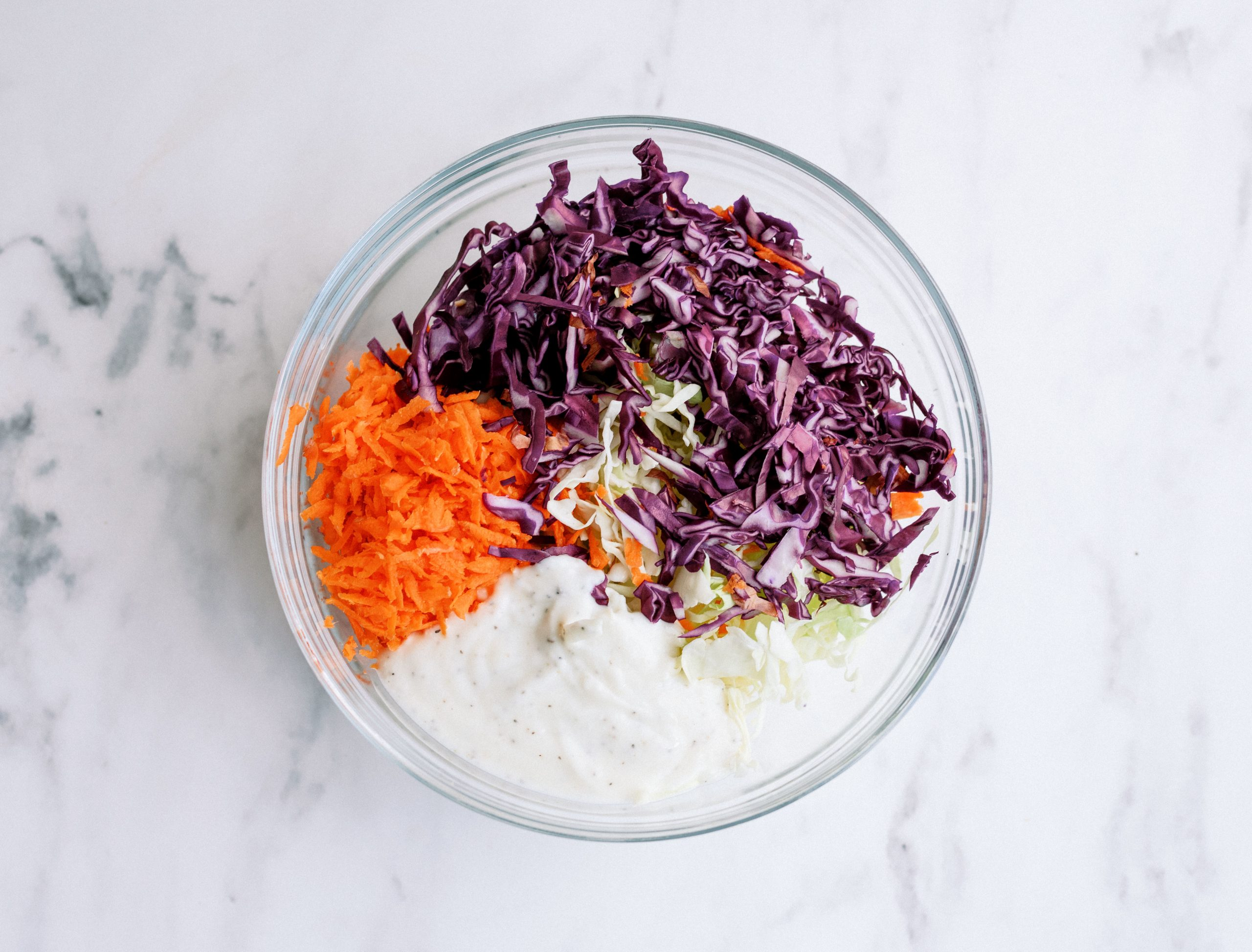 bbq chicken taco coleslaw ingredients in a bowl before mixing