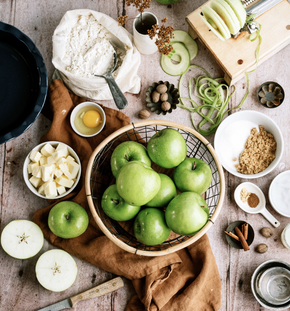 ingredients needed for apple pie laid on a table