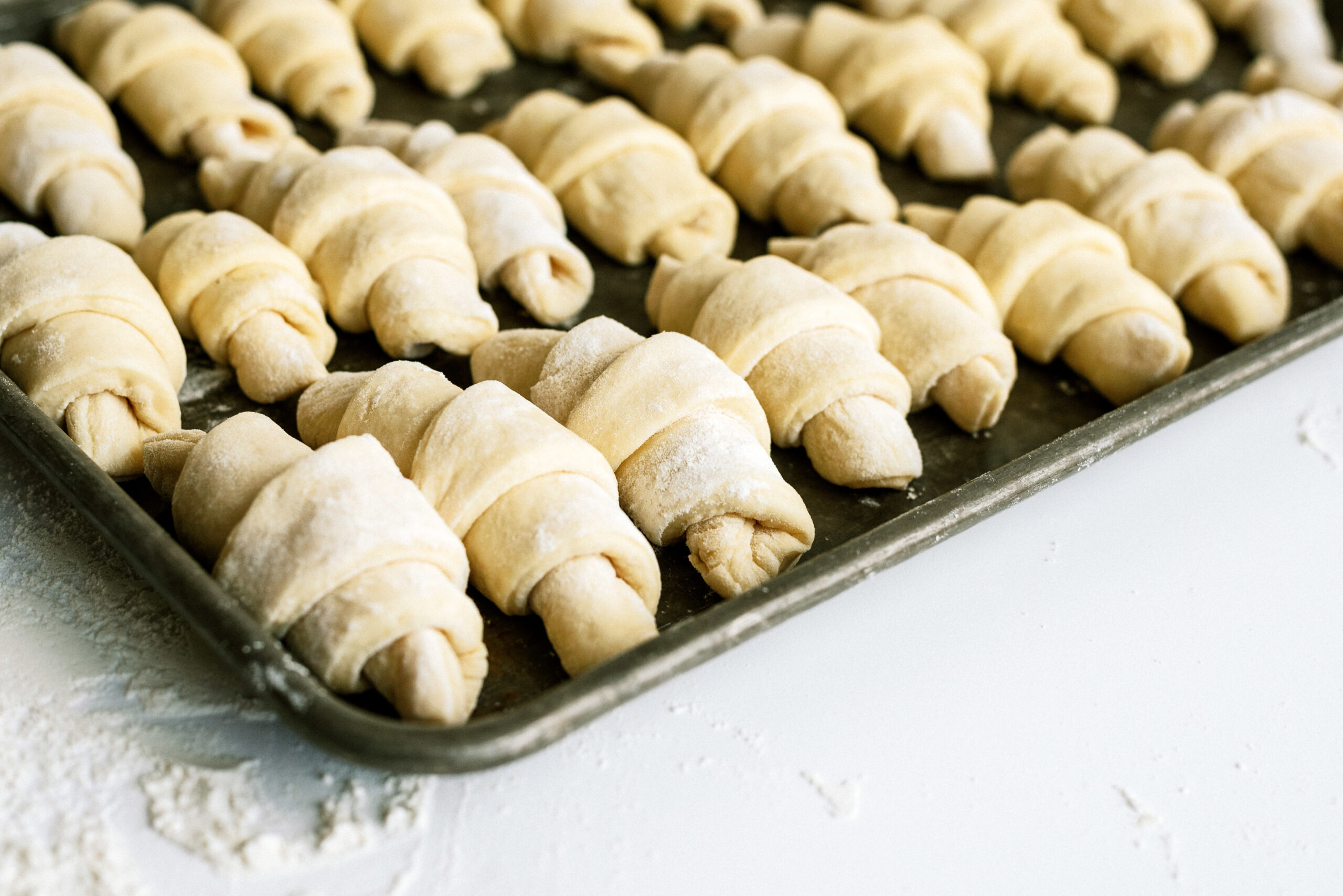 Lion House rolls rising on pan for six sisters stuff