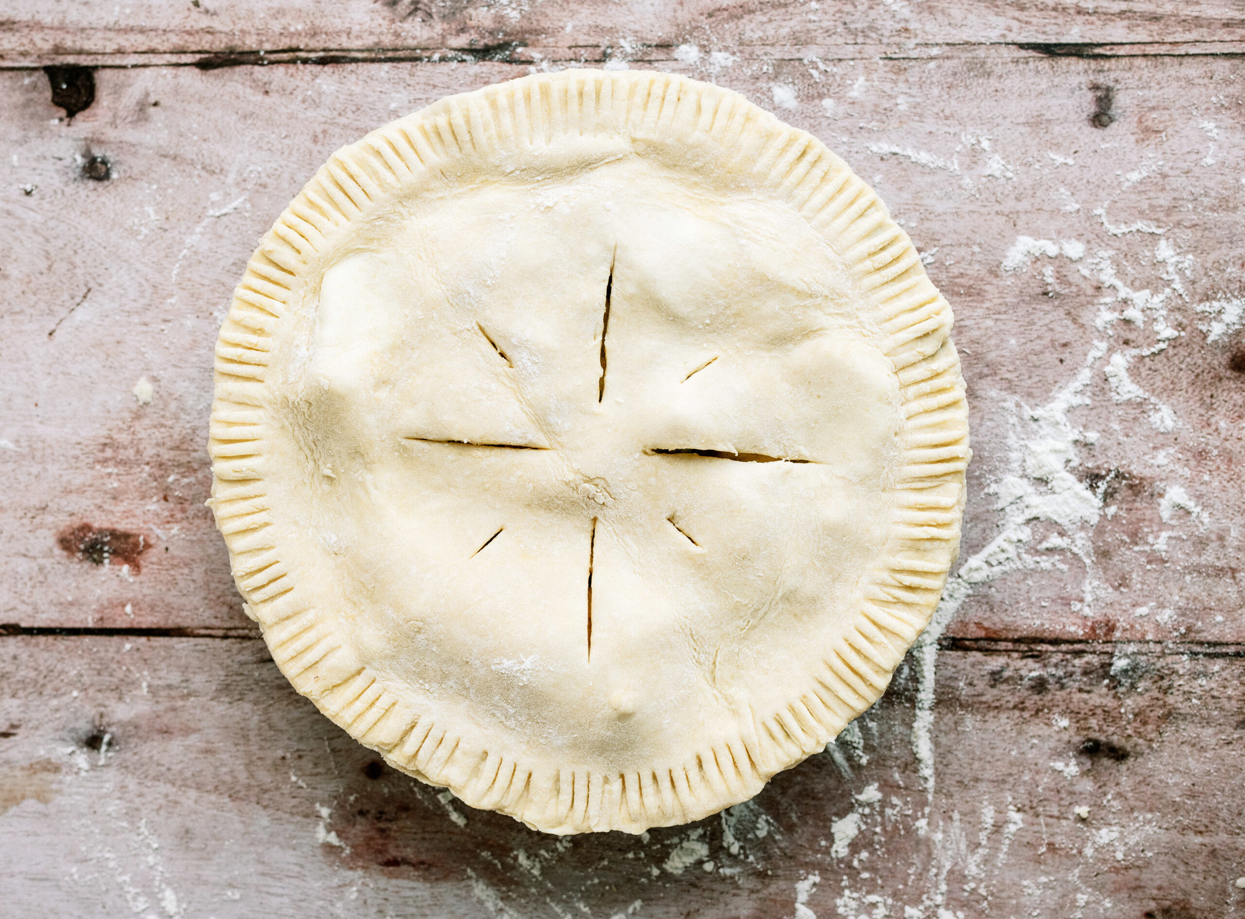apple pie ready to be baked in the oven