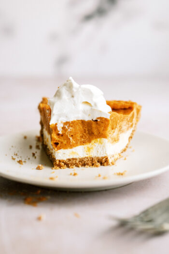 Double Layer Pumpkin Pie with bite out of it