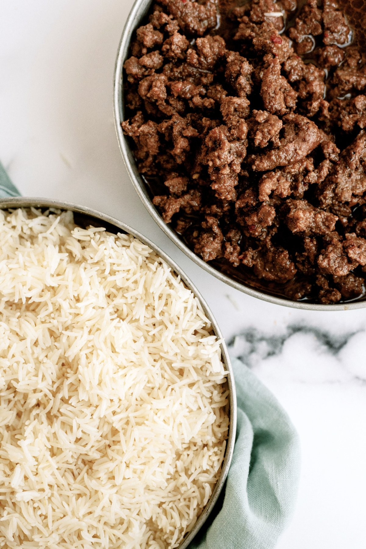 ground beef with rice in bowls from the Instant Pot