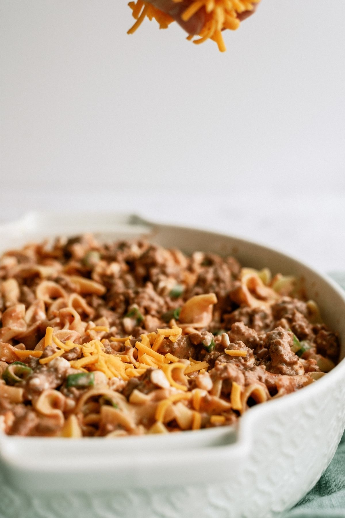Shredded Cheese on Beef and Noodle Casserole
