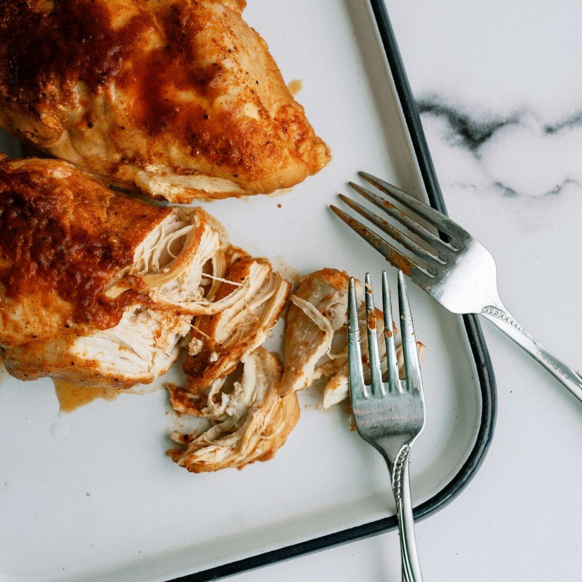 Shredding Instant Pot BBQ Chicken