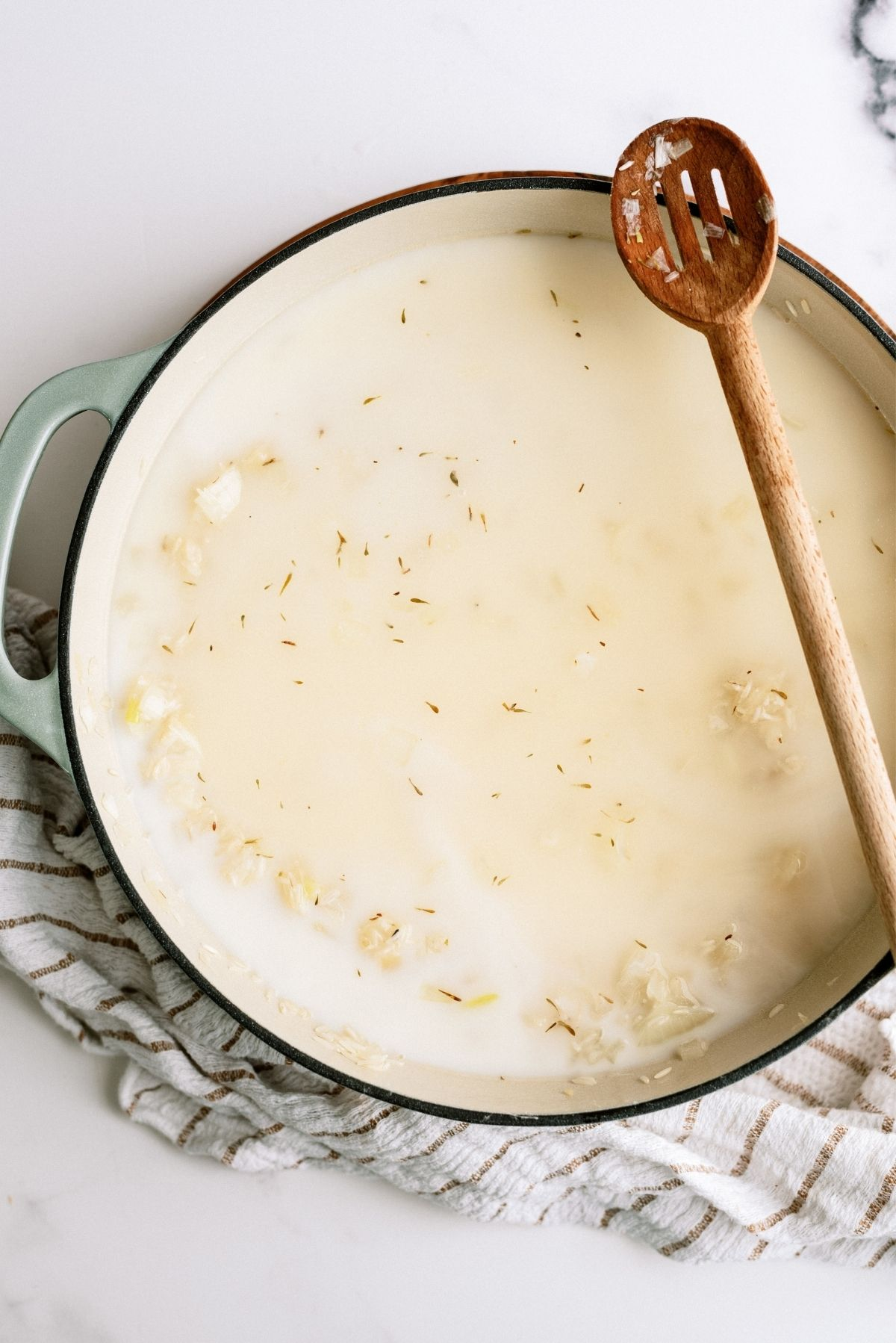 All ingredients in pot for Creamy Chicken and Rice Casserole Skillet