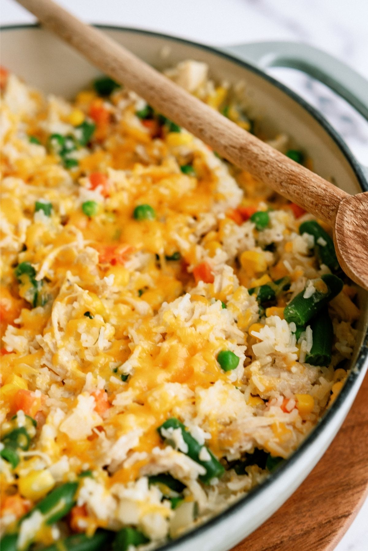 Place lid on pot to melt cheese for Creamy Chicken and Rice Casserole Skillet