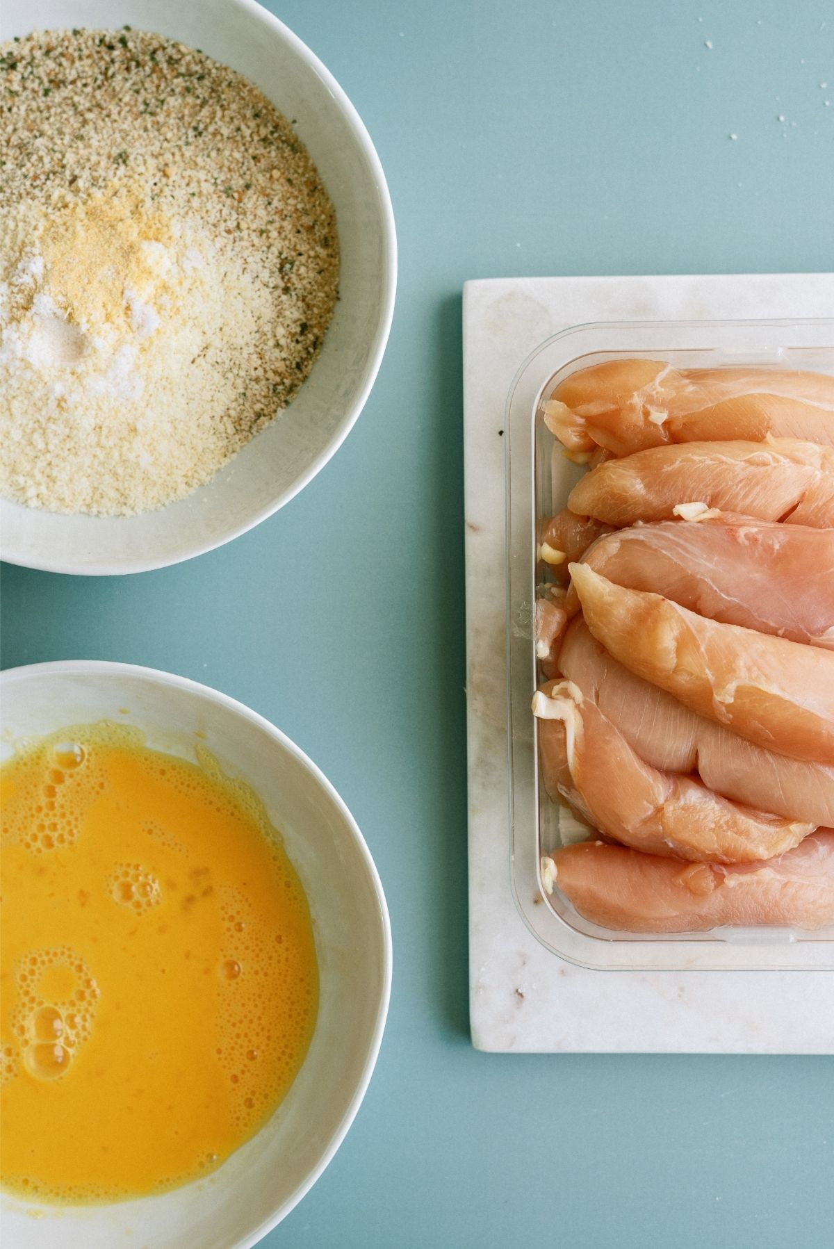 Eggs  and breadcrumbs in bowls for Instant Pot Air Fryer Chicken Tenders Recipe
