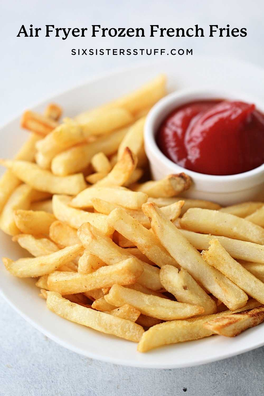 french fries that have been cooked in the air fryer with ketchup on the side