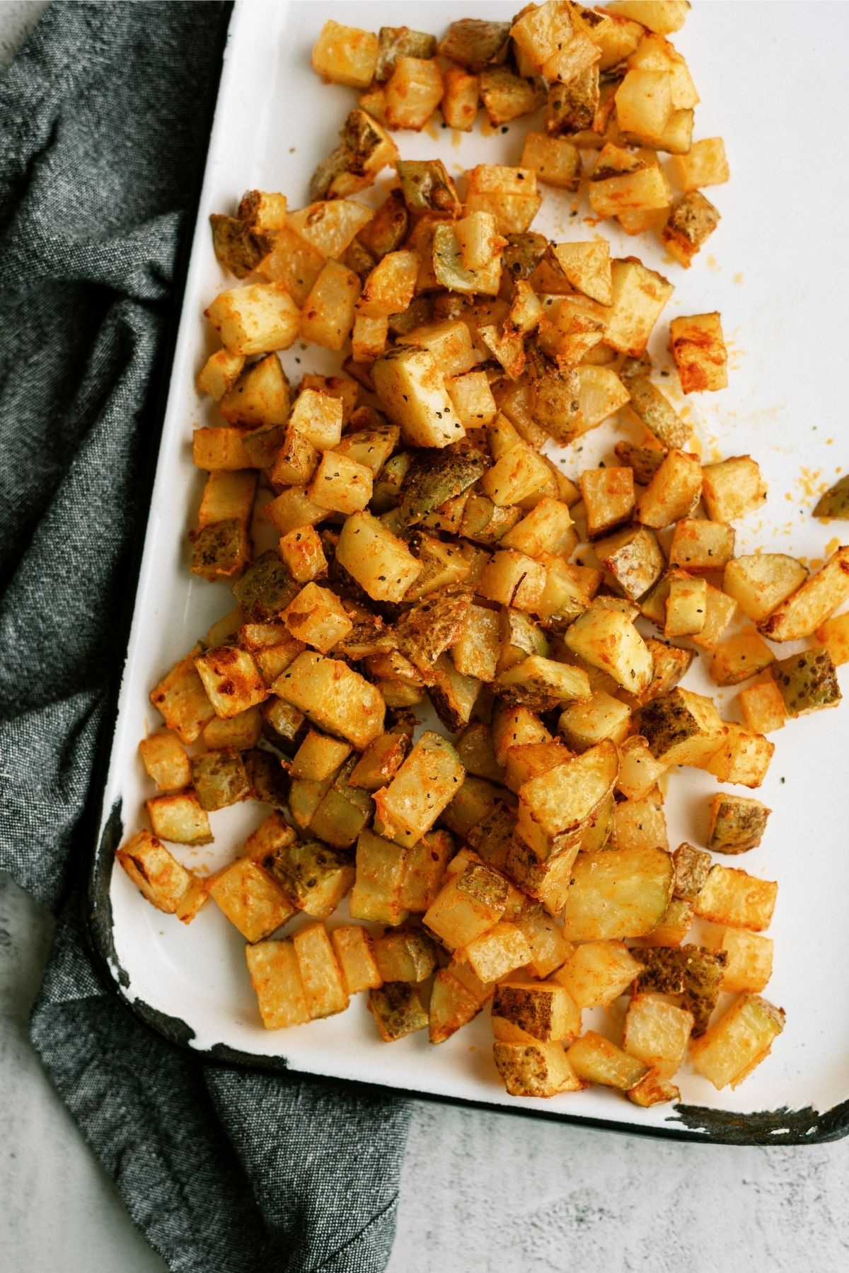 Instant Pot Air Fryer Roasted Potatoes on white serving plater.