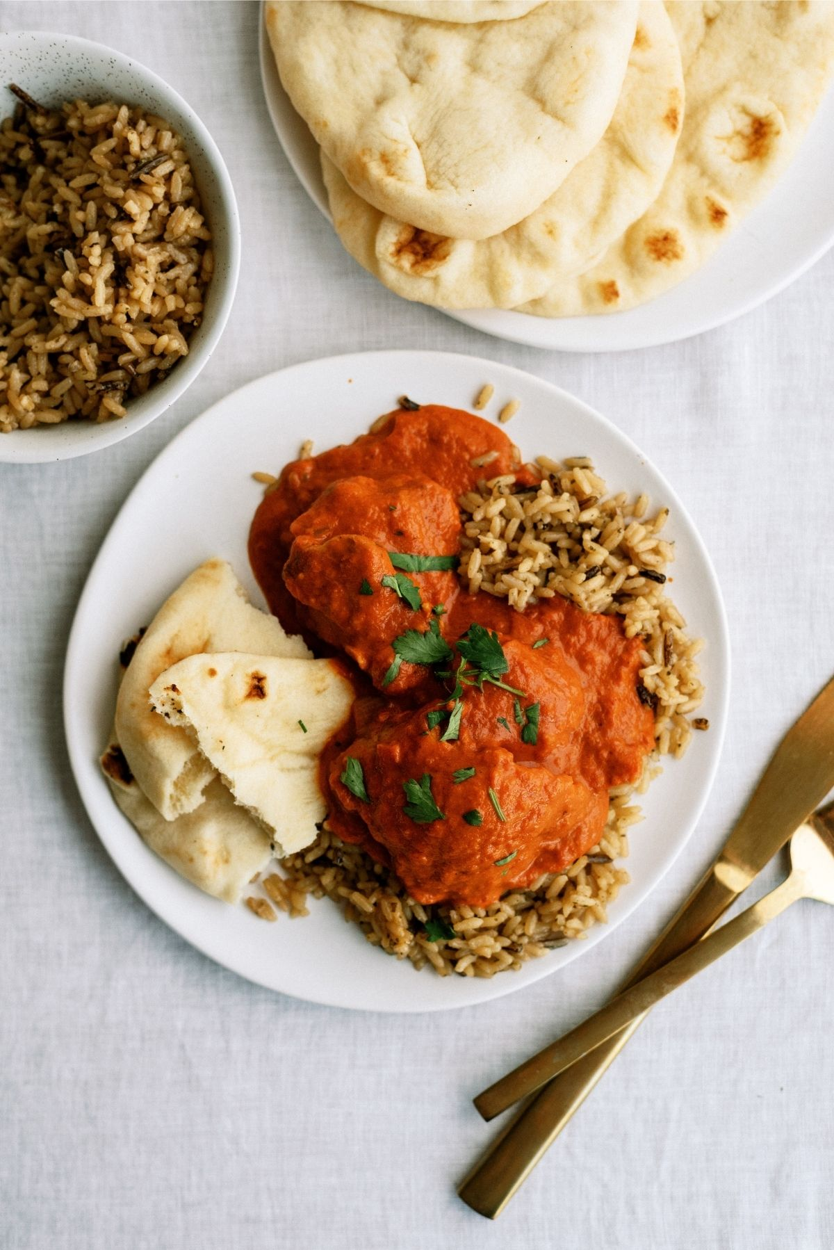 Instant Pot Butter Chicken served over rice on a white place