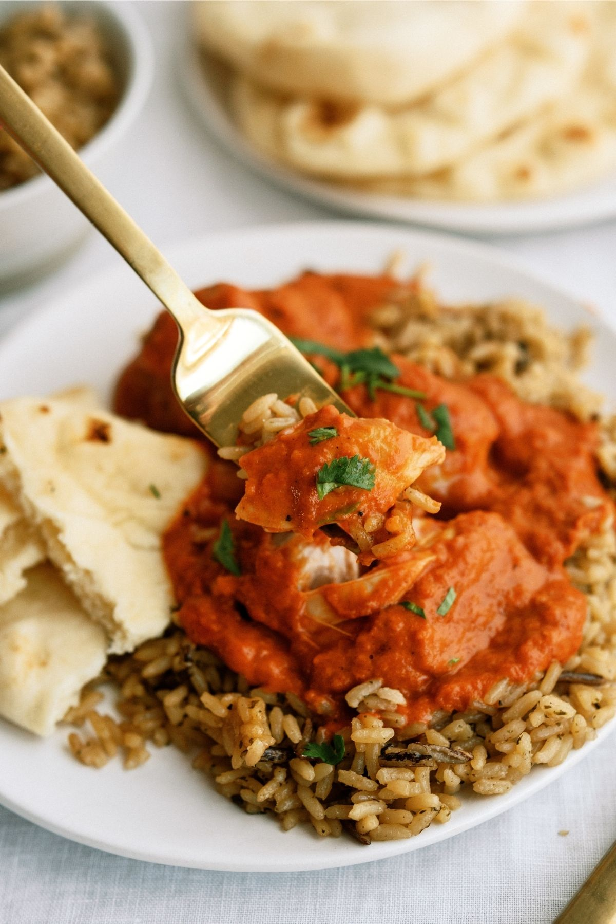 Instant Pot Butter Chicken served over rice on white plate