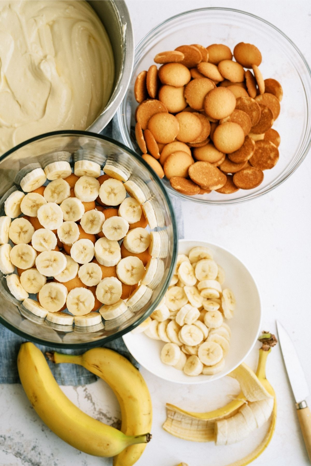 Layer Bananas on top of nilla wafers in trifle dish