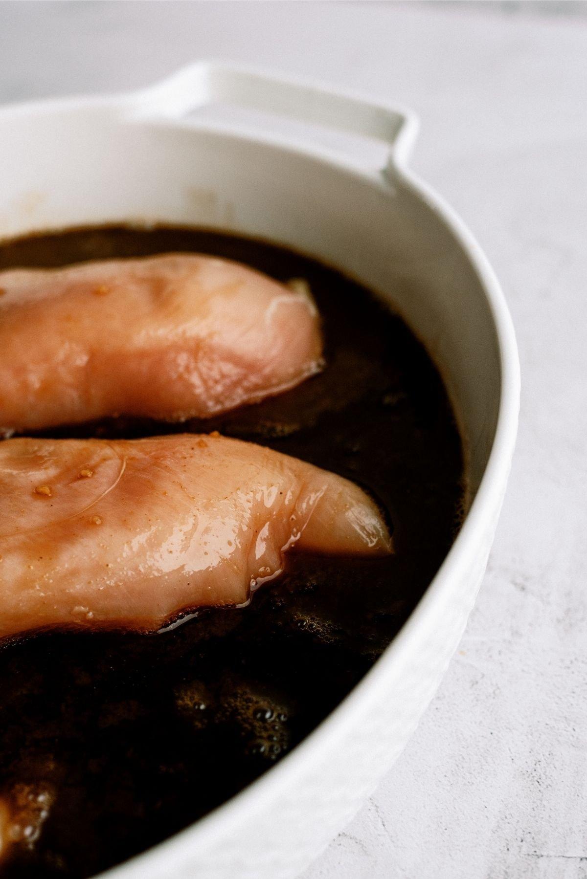 Raw Chicken Breast in sauce for Teriyaki Chicken Casserole Recipe