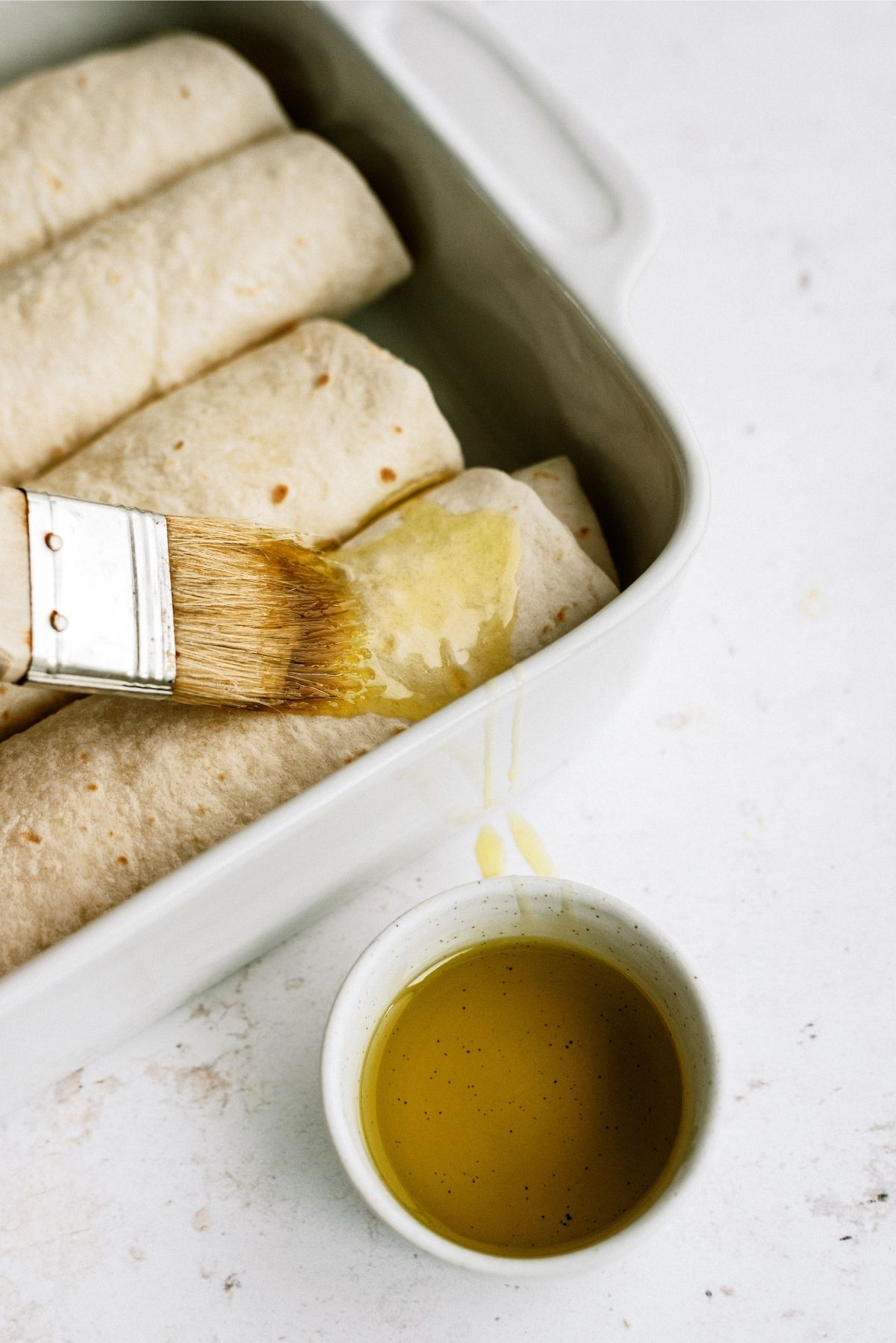 Unbaked Chimichangas with brushed on olive oil