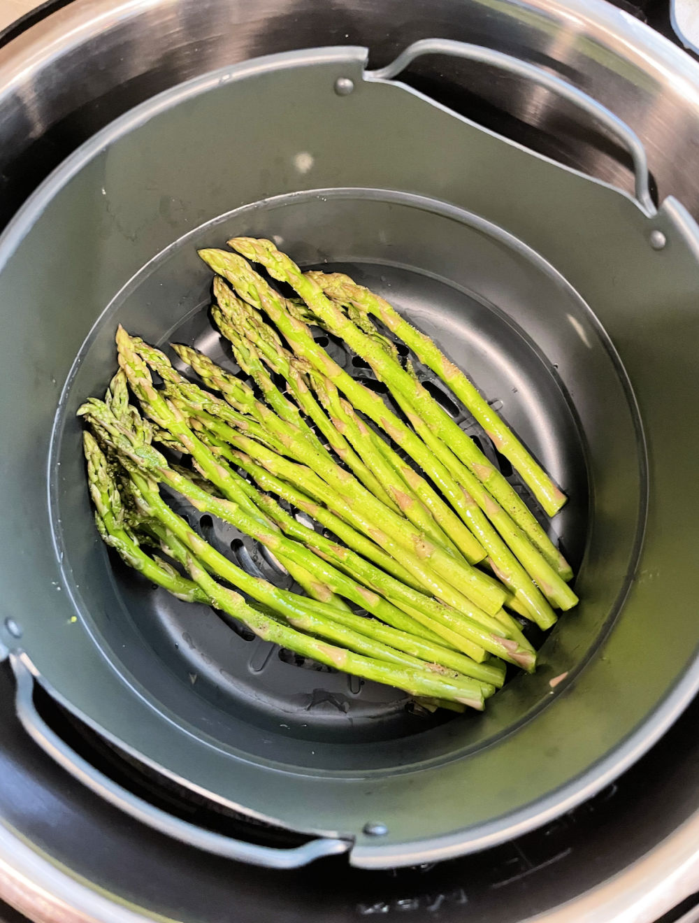 asparagus in the bottom of an air fryer