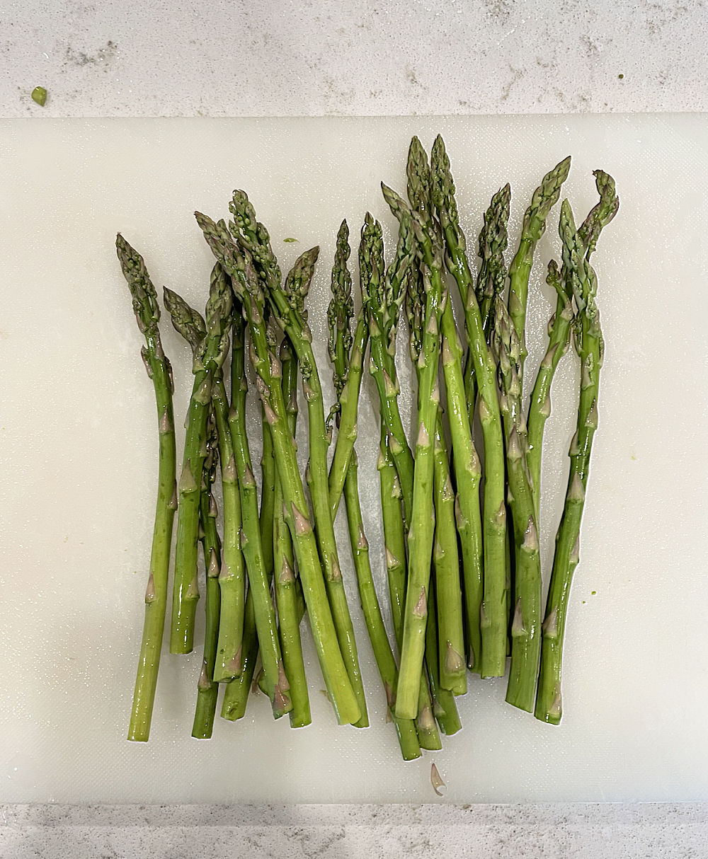 trimmed asparagus on a cutting board