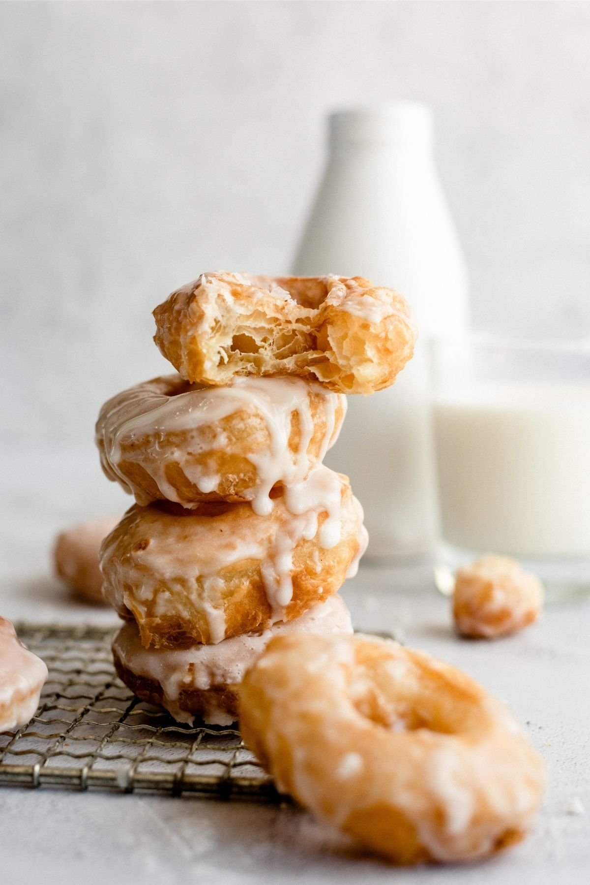 Puff Pastry Donuts stacked on cooling rack