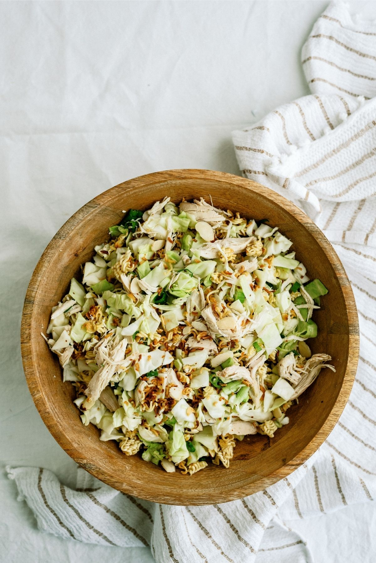 Ramen Noodle Oriental Chicken Salad in a wooden bowl