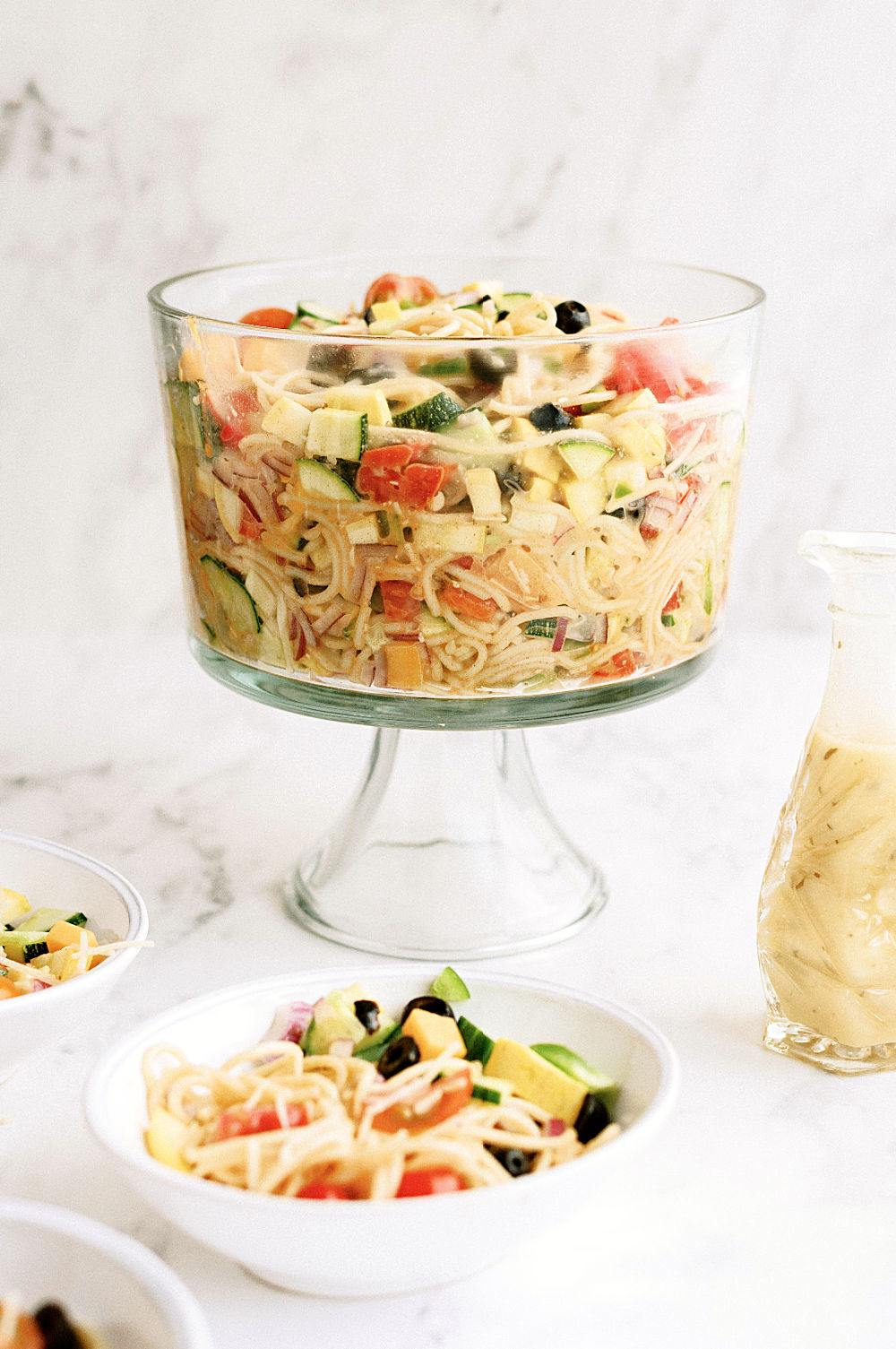 spaghetti pasta salad ready to serve in glass serving bowl