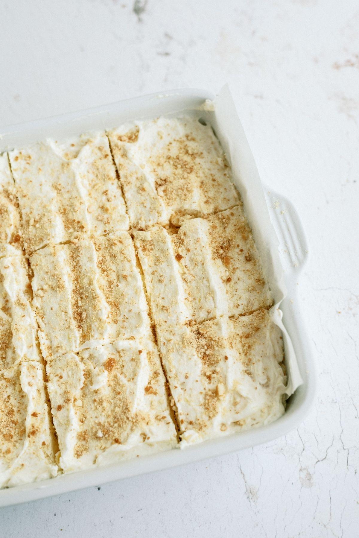 Fluffy Cream Cheese Dessert in pan sliced