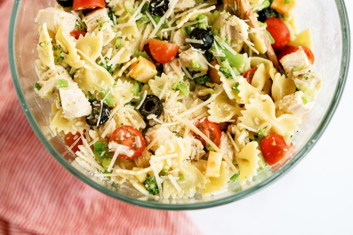 Grilled Chicken Bow Tie Pasta Salad mixed in a glass bowl
