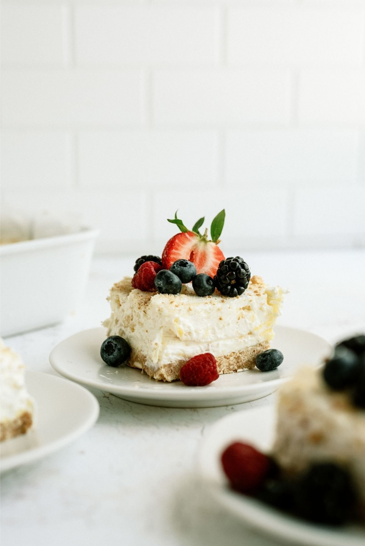 Slice of Fluffy Cream Cheese Dessert on a white plate