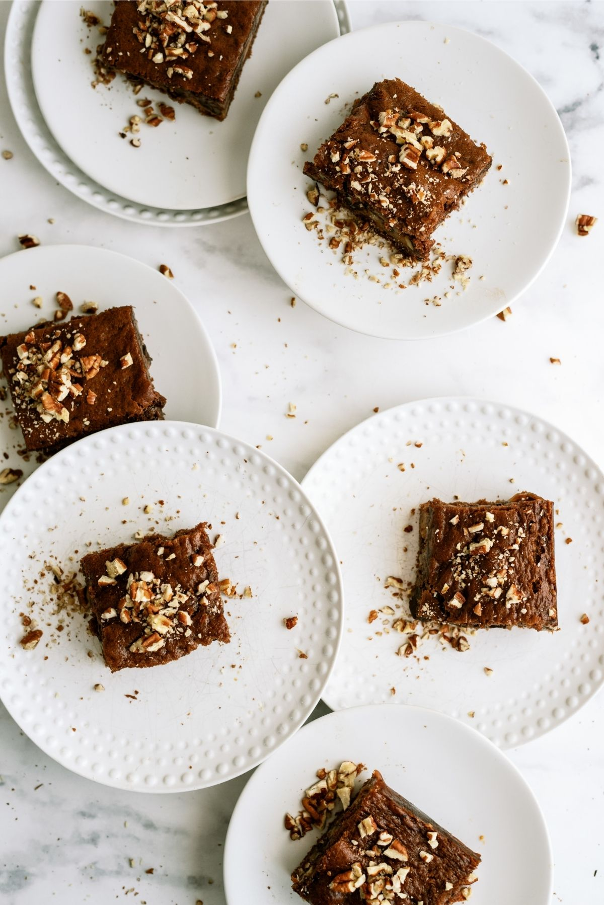 Snickers Cake sliced and served on white plates