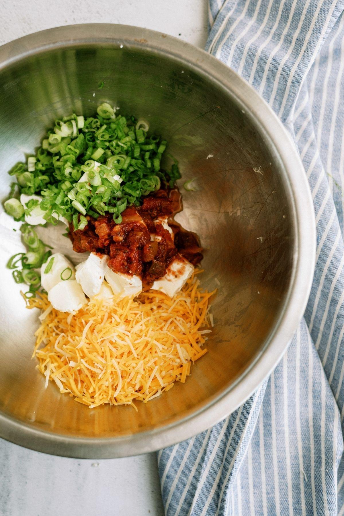 Chicken taco ingredients in metal bowl