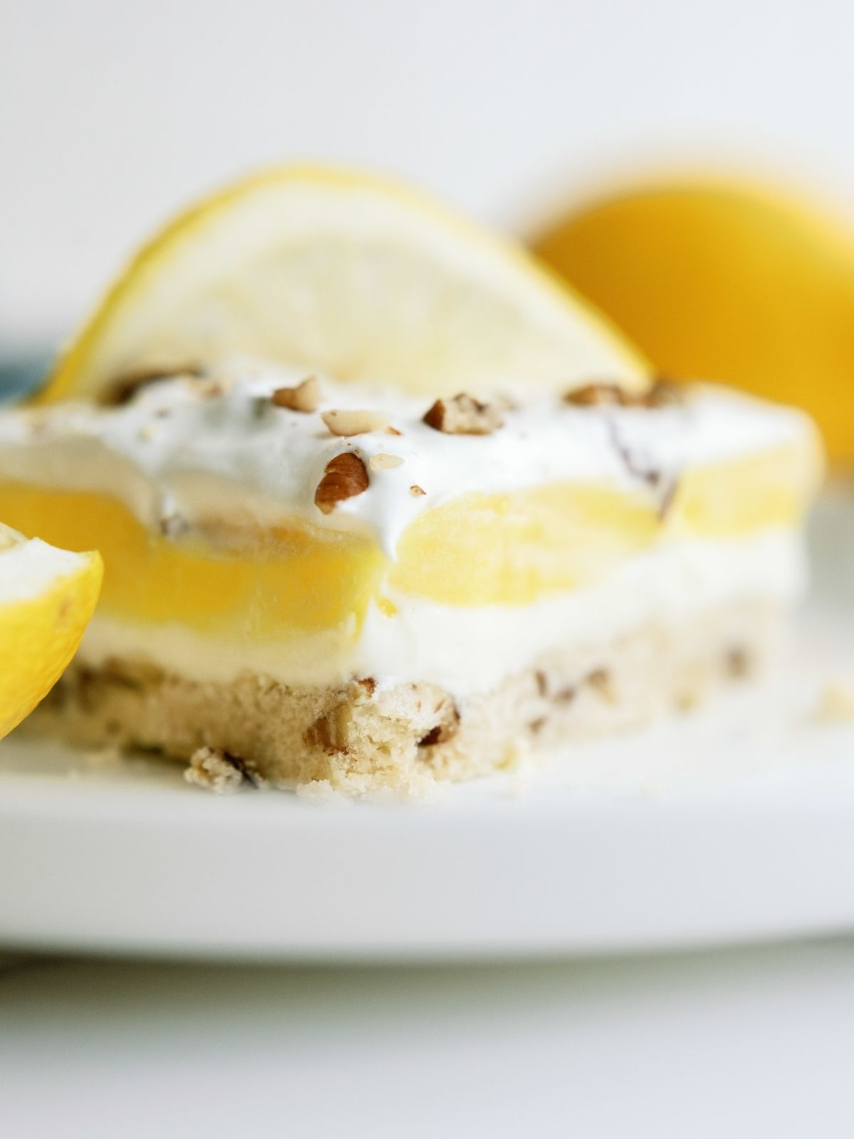 A slice of Layered Lemon Dessert on a white dish