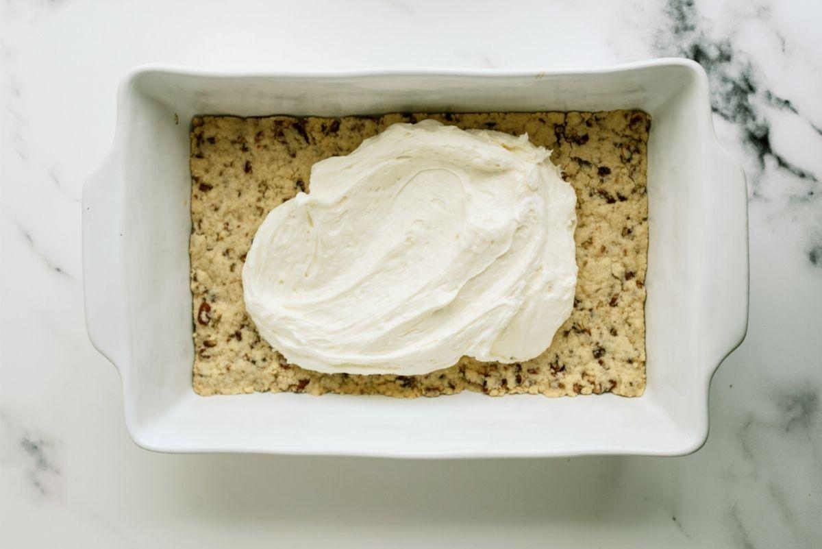 Spreading cream filling over crust
