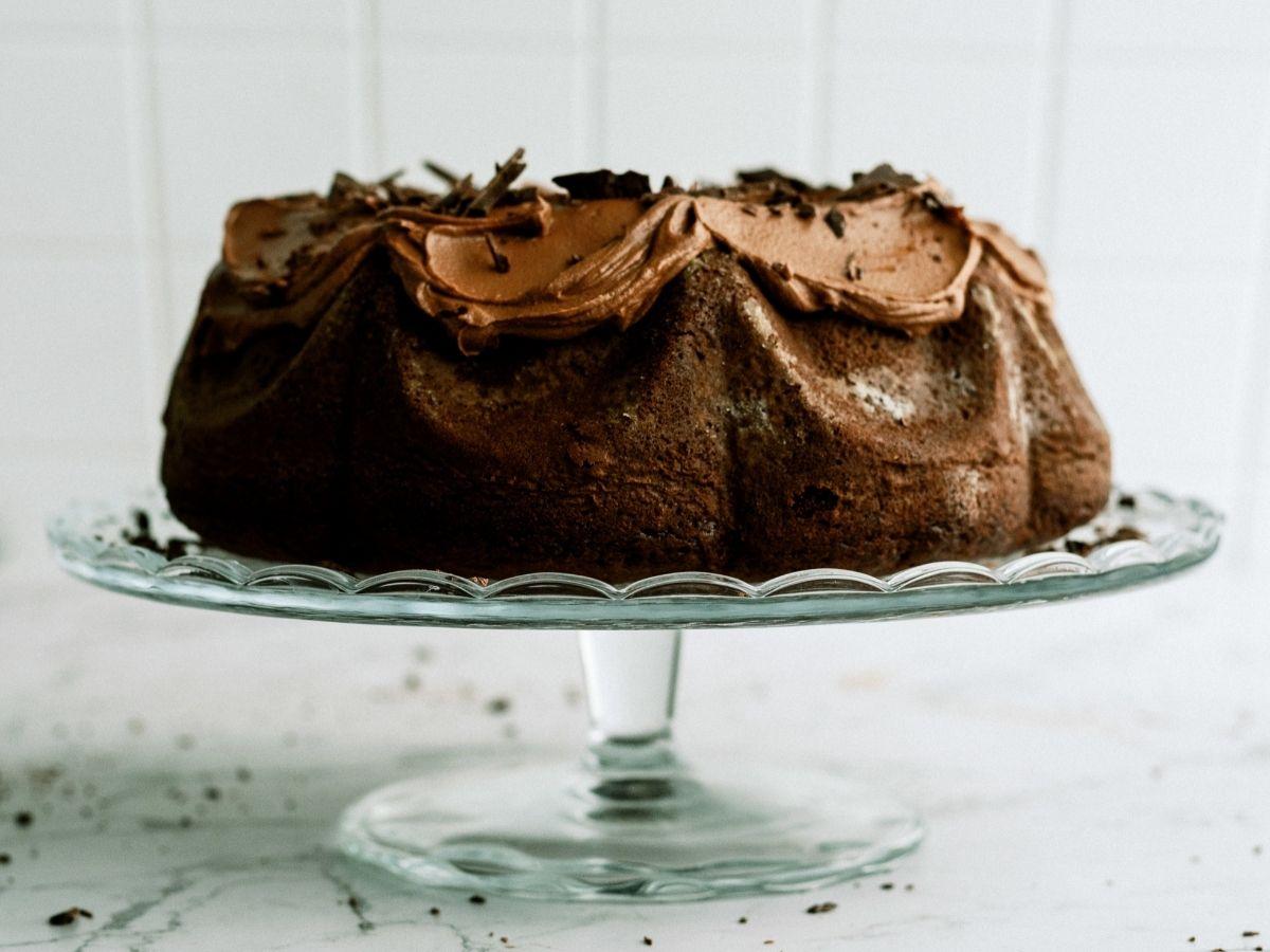 Triple Chocolate Bundt Cake on a glass cake stand