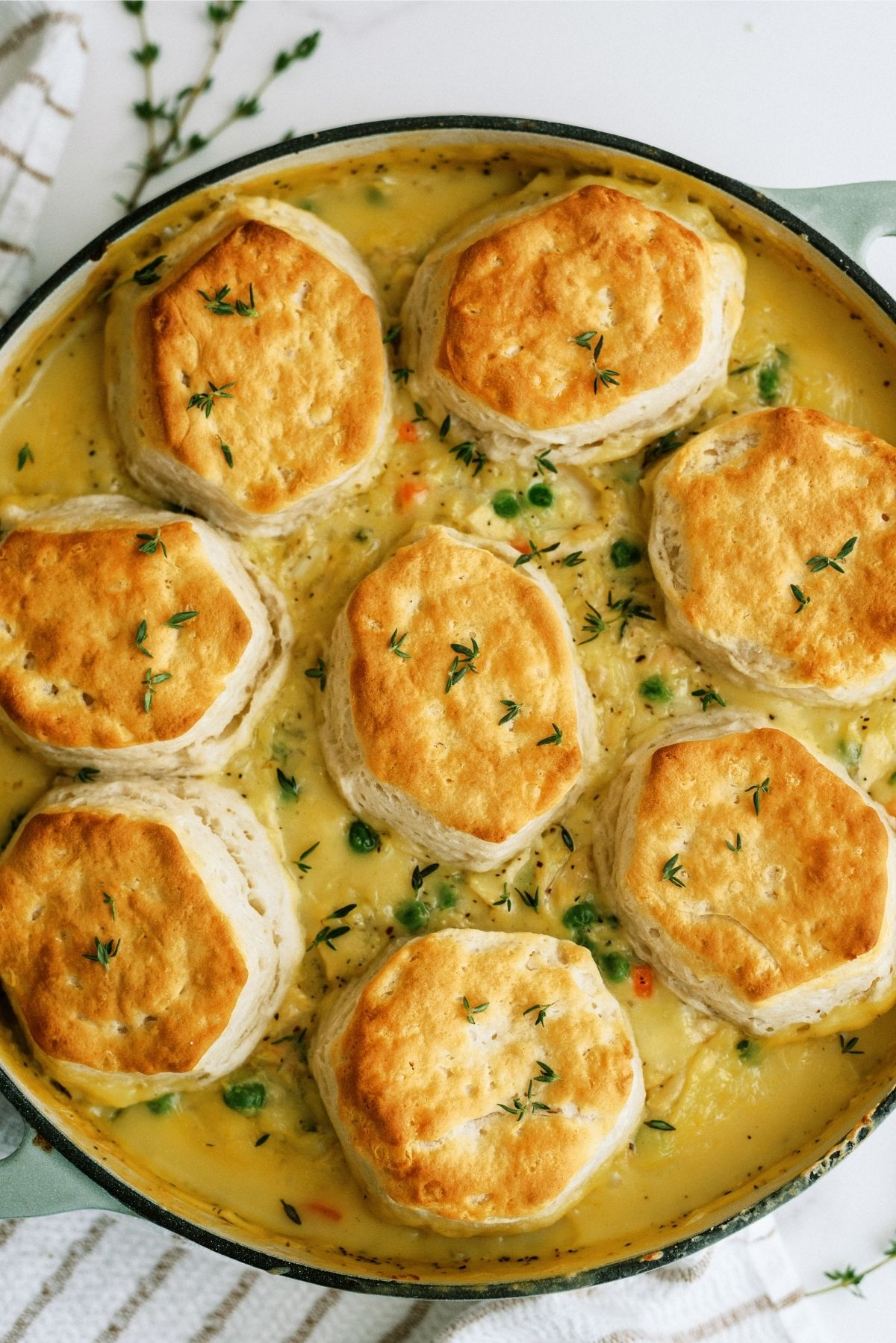 Easy Biscuit Chicken Pot Pie in a round dish on a towel