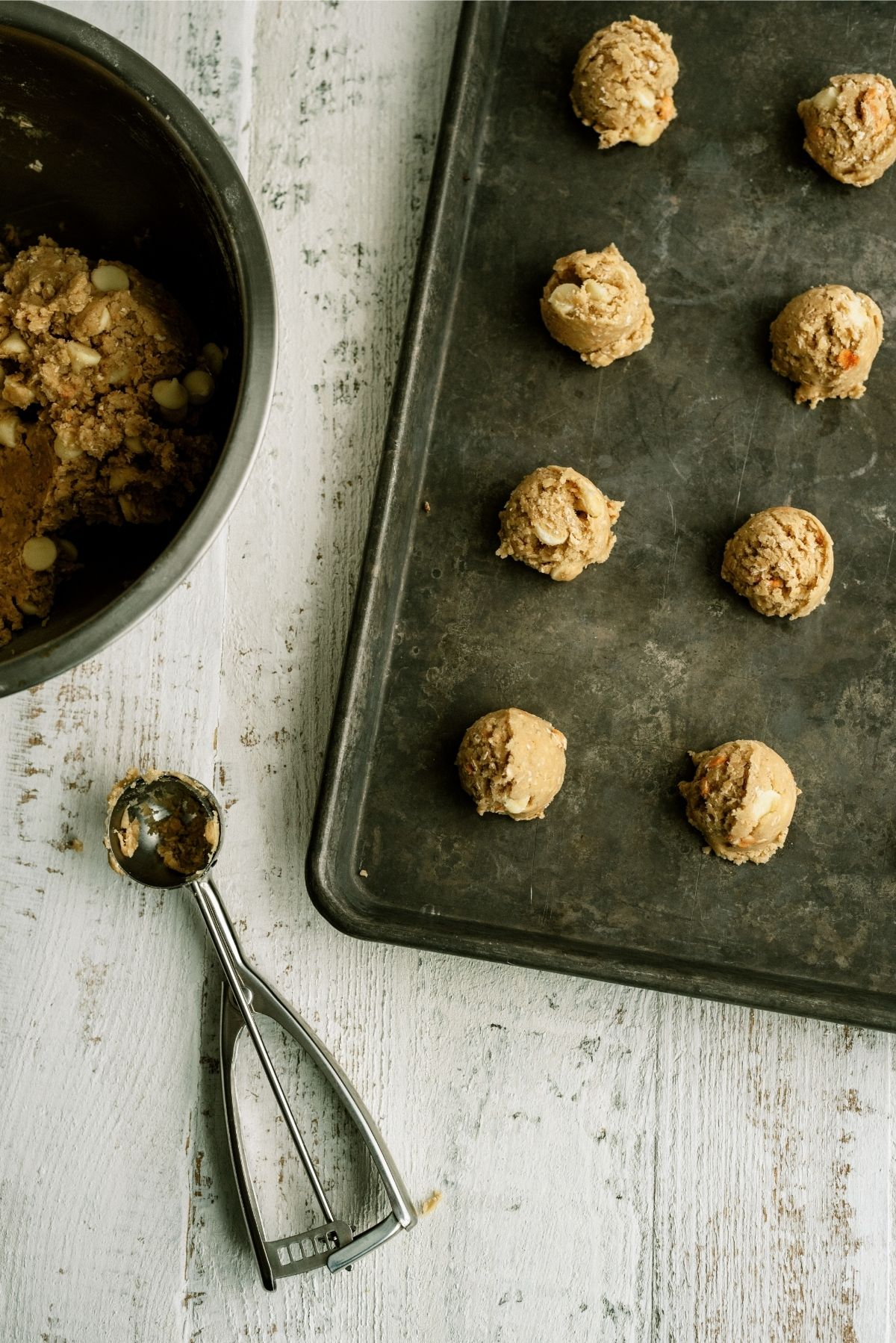 Cookie dough balls on cookie sheet ready to bake