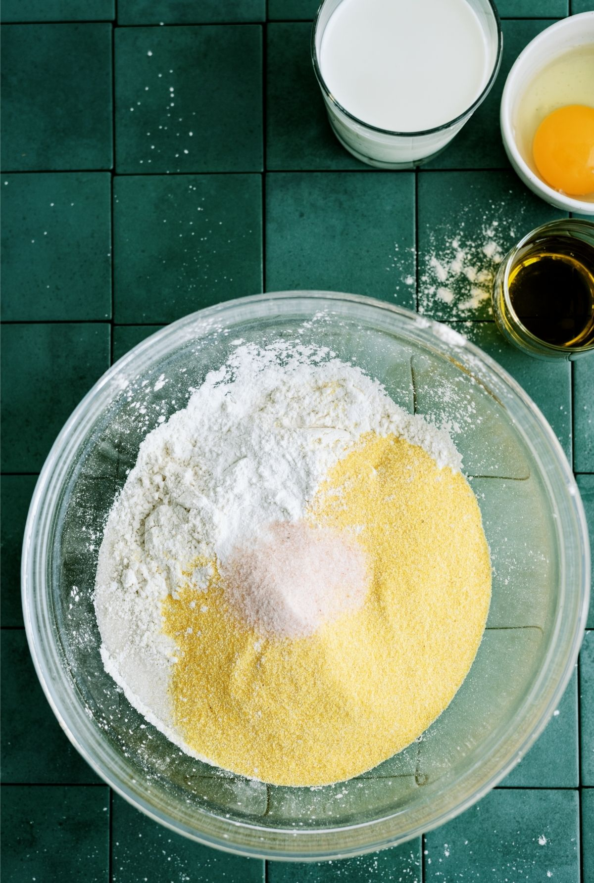 Dry ingredients for Easy Homemade Cornbread mixed in a glass bowl