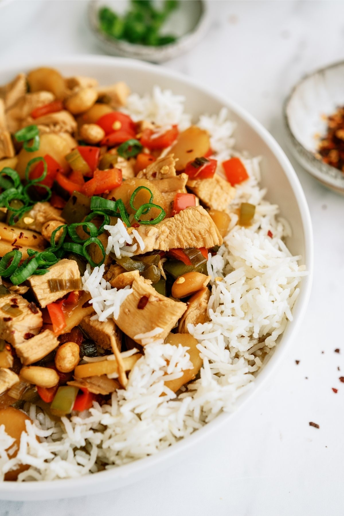 Slow Cooker Kung Pao Chicken Recipe in a bowl served over rice